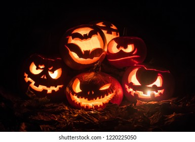 Halloween pumpkins lit by torch