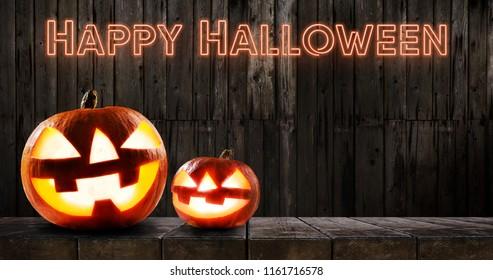 Halloween pumpkins on dark wooden background