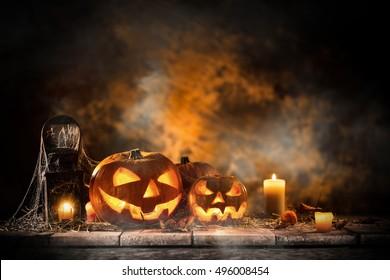 Halloween Pumpkins on old wooden table, still-life.