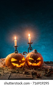 Halloween pumpkins on wooden planks with blue background.