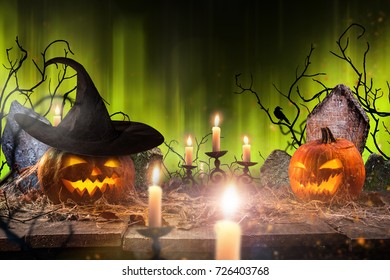 Halloween pumpkins on wooden planks with spooky background.