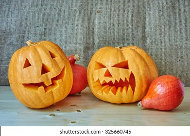 Halloween red and orange pumpkins on a wooden background in a rustic style. Beautiful autumn Pumpkins Halloween background with place for text