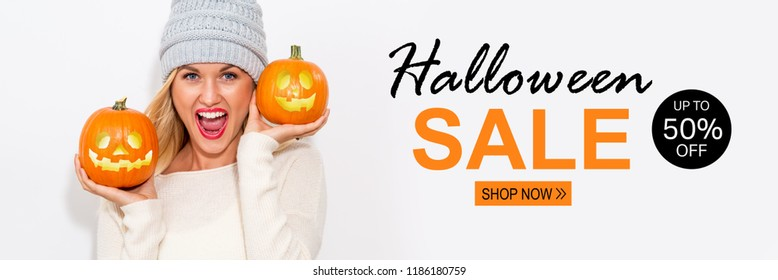 Halloween sale with young woman holding pumpkins