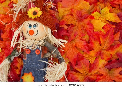 Halloween Scarecrow Scene, Some fall leaves and girl scarecrow with copy-space