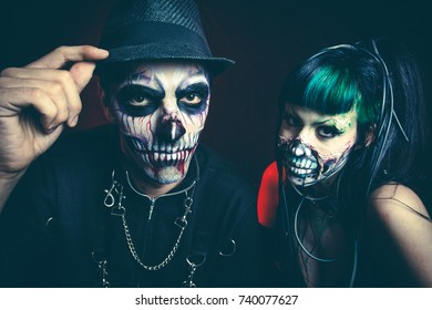 halloween scary cyber skeleton woman and man with hat studio shot