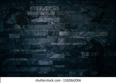 Halloween Scary shadows of witches and bats on a dark brick wall background