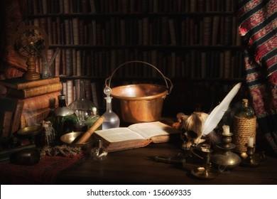 Halloween scene of a medieval alchemist kitchen or laboratory