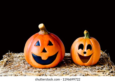 Halloween scene with sculpture or carving pumpkin many sizes with big smile and one show three teeth