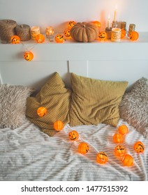 Halloween scenery in the bedroom. Yellow-orange decor for All Saints Day