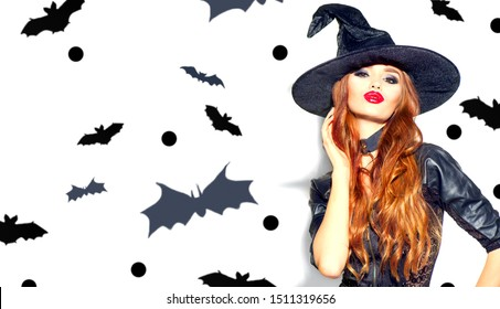 Halloween Sexy Girl wearing witch costume with a hat. Party, Celebrating. Beauty Woman with long hair and holiday bright make-up isolated on white background with bats.