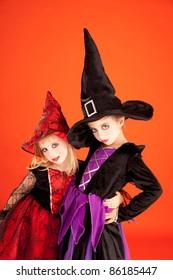 Halloween sister kid girls on orange background