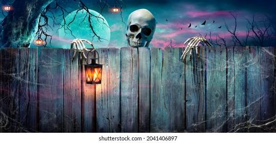 Halloween - Skeleton Holding Lantern On Wooden Banner In Spooky Night