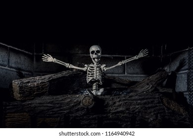 Halloween Skeleton on Fireplace Burned Logs Holding Arms Out with Jaw Open