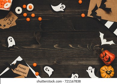 Halloween sweets, halloween cards and decoration made of craft paper. Copy space.