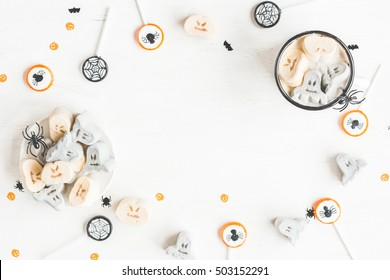 Halloween table. Hot chocolate for halloween on white background. Flat lay, top view