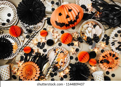 Halloween Table setting. Frame made of black and orange party decoration stuff. Flat lay, top view
