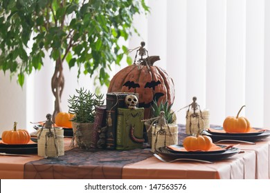 Halloween table setting with squashes and skeletons
