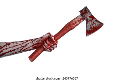 Halloween theme: bloody hand holding a bloody butcher's ax isolated on white background in studio