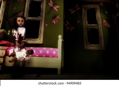 Halloween Theme: Creepy nine year old ghost girl child covered in blood sitting in kids' bedroom with baby doll.