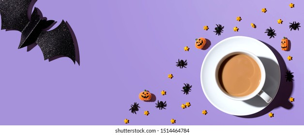 Halloween theme with a cup of coffee - overhead view flat lay