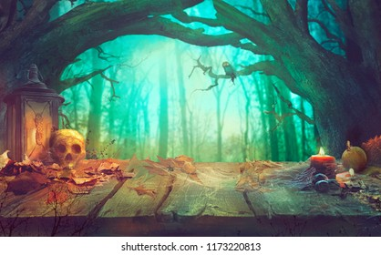 Halloween theme with pumpkins, skull and dark forest. Scary Halloween design on table