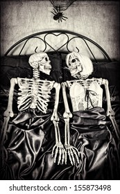 Halloween theme.  Two skeletons in bed together. Textured.
