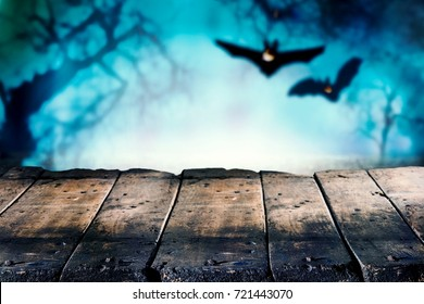 Halloween theme of wooden boards with bats in background