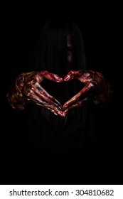 Halloween theme:Bloody hands in heart , black background, zombie, demon, killer, maniac with clipping path.