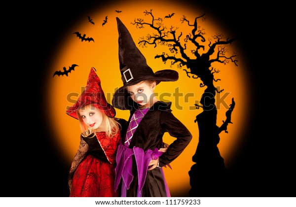 Halloween two children girls with tree and bats on orange background