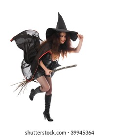 Halloween witch flying on the broom. Isolated