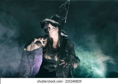 Halloween witch on smoke green and purple background