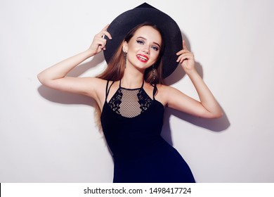 Halloween Witch on white background. Halloween Party girl. Happy Halloween Witch smile. Beautiful young surprised woman in witches hat and short. Halloween Witch on white background.