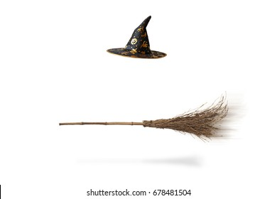 Halloween witch's hat and broom isolated