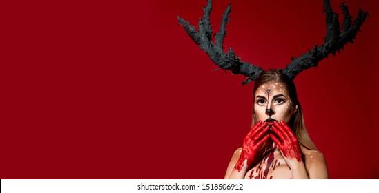 Halloween. Woman dead deer mask face art. Halloween make up