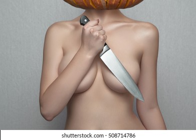 Halloween Woman holding Knife Blade on her Breasts