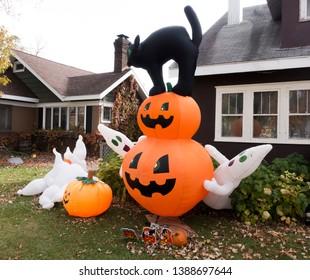 Halloween yard display of jack-o'-lanterns, ghosts and black cat. Fergus Falls Minnesota MN USA