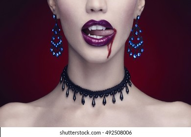 halloween,beautiful woman,vampire. beauty make-up and jewelry