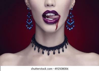halloween,beautiful woman,vampire. beauty make-up and jewelry