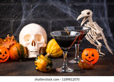 Halloweens spooky drink for party black martini cocktail