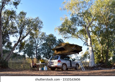 Halls Creek, Australia - 07 23 2019: Stunning free camping spot at Caroline Pool near Halls Creek for a Hyundai Santa Fe with roof top tent