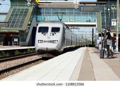 Hallsberg, Sweden - June 8, 2018: A grey colored SJ class X2 high speed express train X2000 service between Stockholm and Oslo via Karlstad arrives at Hallsberg station.