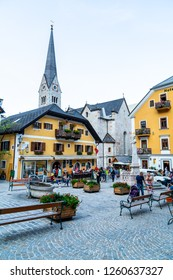 HALLSTATT, AUSTRIA - 29 AUGUST 2018: Town square in Hallstatt, Austria. Hallstatt is historical village located in Austrian Alps at the Hallstatter lake and promoted by UNESCO World Heritage region.