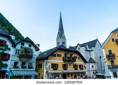 HALLSTATT, AUSTRIA - 29 AUGUST 2018: Town square in Hallstatt, Austria. Hallstatt is historical village located in Austrian Alps at the Hallstatter lake and promoted by UNESCO World Heritage region.