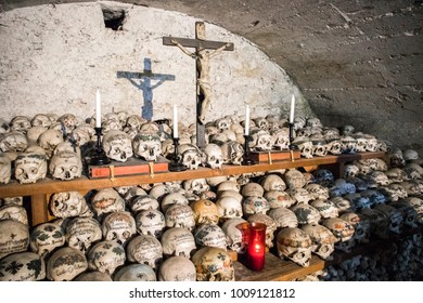 HALLSTATT, AUSTRIA - August 6, 2017: Skulls painted with names, colorful flowers and crosses in the Charnel House or Beinhaus, Hallstatt, Austria