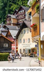 HALLSTATT, AUSTRIA - JULY 24, 2015: Town square of Hallstatt, Colorful small mountain village that is UNESCO world heritage site in Austria Salzkammergut region.