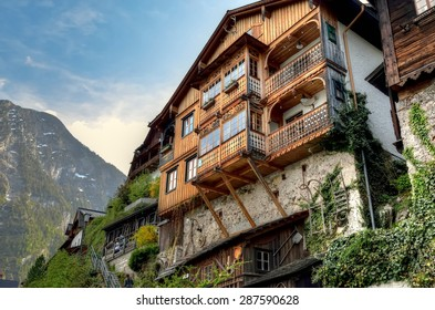 HALLSTATT, AUSTRIA - MAY 3, 2013: Wooden alpine house in Hallstatt, Austria. Hallstatt is historical village in Austrian Alps at the Hallstatter lake and promoted by UNESCO World Heritage region.
