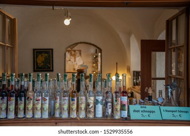 HALLSTATT, AUSTRIA, OCT 12, 2019: variety of local liquors in a window of family shop on sale for tourists.
