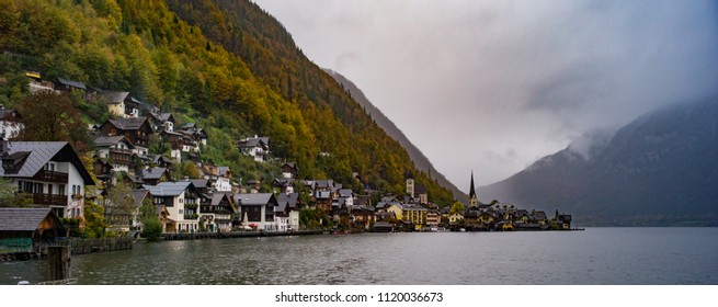 HALLSTATT, AUSTRIA - OCT 21: Historical houses on the shores of Hallstatt Lake on a rainy day on October 21, 2013 in Hallstatt, Austria. Hallstatt is known for the most beautiful town in Austria.