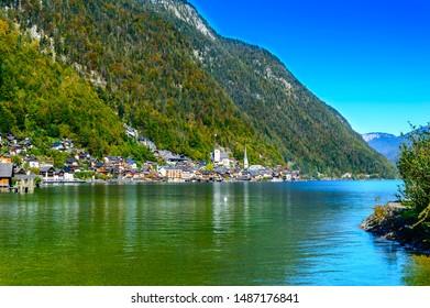 Hallstatt, Austria. Picturesque town on alpine lake Hallstatter See in Austrian Alps mountains. Autumn season. Romantic mountain village. Popular tourist destination for vacation, hiking, relaxation.