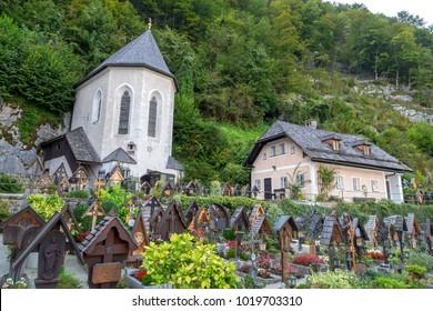 HALLSTATT, AUSTRIA - SEPTEMBER 14, 2016 : Beinhaus Ossuary known as bone house with small cemetery in the garden, in Hallstatt on Alp Mountains.